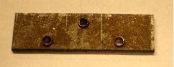 "Picture of Body Part Mounting Nut, Triangle 1/4"" Holes"